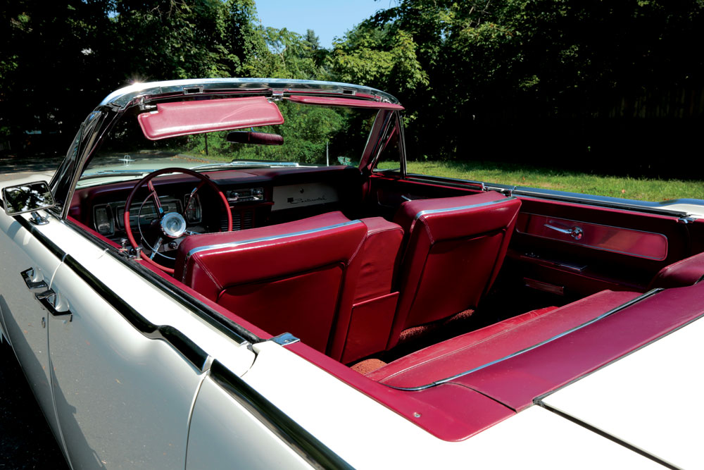 Most of the Lincoln's interior, including its red leather seats, is in its original condition.