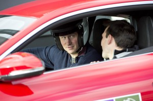Prince Harry getting ready to drive a Jaguar F-Type on track day at Goodwood.