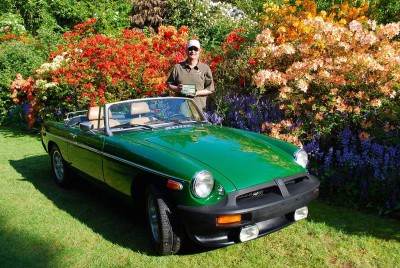 John Stanichak, a proud class winner for his later edition, fully restored MGB, at the 2012 Vancouver All British Field Meet at VanDusen Botanical Garden.