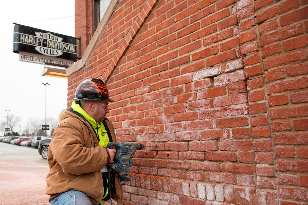 Mason Kenneth Glyzewski removes bricks from the Harley-Davidson facility, which will be placed at a Harley-Davidson plaza in Sturgis, South Dakota. Photo: CNW Group/Deeley Harley-Davidson Canada.