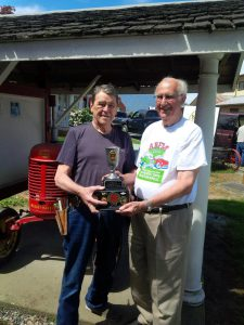 Barry Mason (right) long time friend of the 2016 ABFM Spirit Award winner Gerry Parkhill shares the moment at the ‎Chilliwack Agricultural Museum where Gerry is responsible for acquiring and maintaining many of the exhibits.