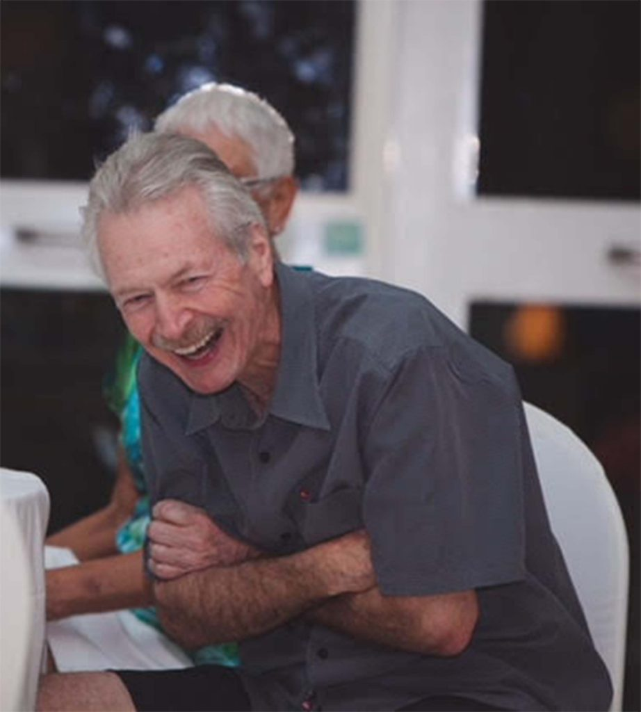 Paul Barlow shares a laugh with friends.