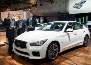 2014 Automobile Journalists' Association of Canada (AJAC) awards—(L-R) Wendy Durward, director Infiniti Canada; Christian Meunier, president Nissan Canada; and Tim Franklin, senior manager product planning Infiniti Canada with Infiniti's 2014 Q50 sports sedan—winner Best New Luxury Car (over $50k), Best New Innovation Technology and Best New Safety Technology awards.