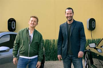 """Actors Alex Winter (left) and Keanu Reeves ready their Taycans with a full charge before """"Going the Distance."""""""